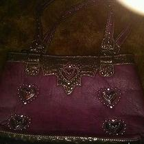Leather Handbag With Hearts Photo