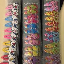 Little Girl Barrettes. Hello Kitty and Other Designs. 3 Packs Photo