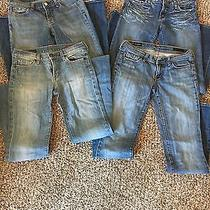 Lot of 4 Pairs of 7 for All Mankind Express and Citizen Jeans Photo