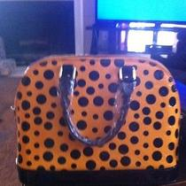 Louis-Vuitton-Alma-Mm-in-Yellow-Embossed-Patent-Calf-Leather Photo