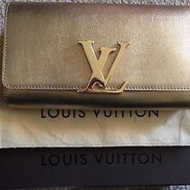 Louis Vuitton Gold Clutch Photo