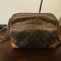 Louis Vuitton Nile Messenger Monogram Bag Photo