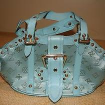 Louis Vuitton Theda Rare Photo