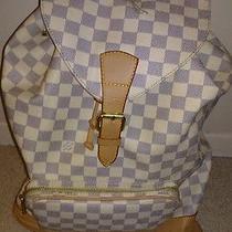 Louis Vuittons Bookbag Photo