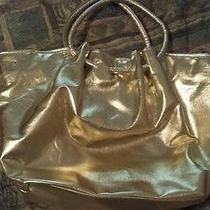 Mariah Carey Gold Bag Photo