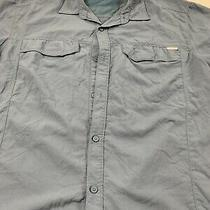 Men Large Columbia Button Up Blue Shirt. Side Pockets. 100% Nylon. Vented Photo