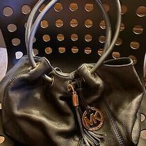 Michael Kors Black Pebbled Leather Hobo Purse With Black Tassel Photo