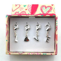 N29 Avon Silvertone Cute Love Charm Set Brand New in Original Box Photo