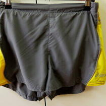 New Grey & Yellow Asics Duo Tech Shorts - Size 10 Photo