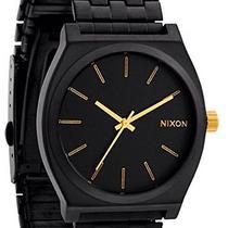 Nixon Time Teller Matte Black and Gold Watch  Photo