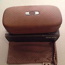 Oakley Case New in Box With a Brown Oakley Microfiber Photo