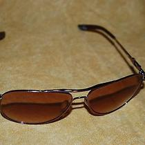 Oakley Daisy Chair Woman's Sunglasses in Smoked Rose Color Ce 139 60-14   Photo