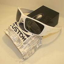 Oakley Fuel Cell Polished White Frame Black Iridium Polarized Lens Photo