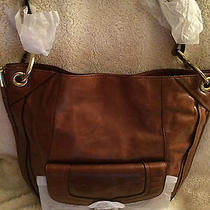 Oryany Glazed Leather Camilla Hobo Cognac Look Photo
