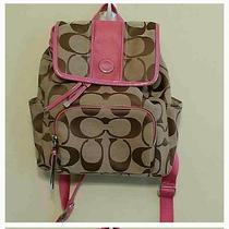 Pink and Brown Coach Backpack Photo