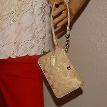Pre-Owned Coach Gold Wristlet Photo