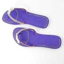 Purple Flip Flops With Pearls  Photo