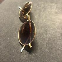Ray-Ban Round Metal Men's Sunglasses - Gold Frame With Green Polarized Lens Photo
