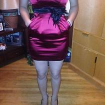 Short Strapless Formal Bebe Dress Photo