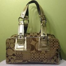 Signature Coach Gold Handbag Photo