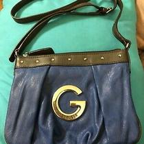 Small Blue Guess Purse With Long Shoulder Strap Photo