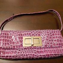 The Limited Purple Croc Bag Photo