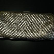 The Limited Silver Metallic Clutch  Photo