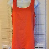 The Limited Size Small Orange Top Photo