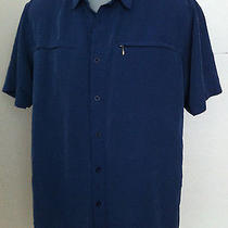 The North Face Mens Outdoor Vented Blue Hiking Shirt Photo
