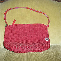 The Sak Red Purse Handbag. Photo