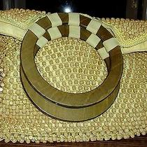 The Sak Yellow Fabric Bag Covered in Wood Beads Photo