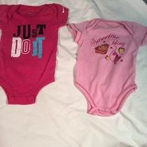 Two Infant Girls Onesies. Nike and Baby phat.pink. Photo