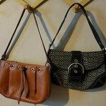 Two Name Brand Purses Black Signature Coach and Brown Leather Dooney and Bourke Photo