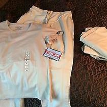 Two Sets of Beige Scrubs Photo