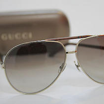 Unisex Gucci Gold Aviators Photo