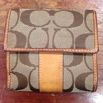 Used Small Coach Wallet Tan With Orange Lining Photo