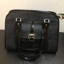 Used Vera Wang Black Pocket Book. Photo