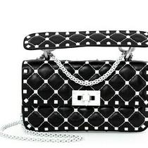 Valentino Garavani Rockstud Matelasse Quilted Crossbody Clutch Bag Black & White Photo