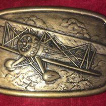 Vintage Brass Belt Buckle Signed Avon Displaying Dual Engine Piper Airplane Photo