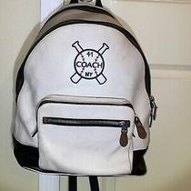 White and Blue Leather Coach Backpack. With Lots of Room to Put Your Belongings Photo