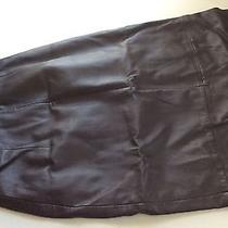 Woman Black Leather Skirt Photo