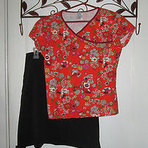 Woman's Medium Patagonia Orange Floral Short-Sleeve Shirt and Black Skirt Photo