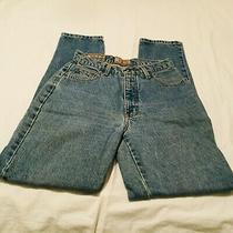 Woman's Medium Wash Jeans by Express Size 7/8. Inseam 31