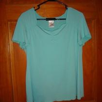 Woman's Teal Scoop Neck Blouse Photo