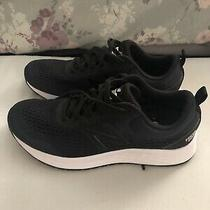 Women's Black and White New Balance Arishi Running Shoes Size 9.5 Photo