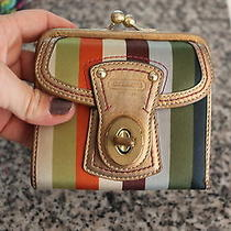 Women's Gold Trim Coach Bi Fold Wallet Photo