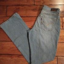 Women's Levi's 515 Boot Cut Medium Wash Stretch Blue Jeans Size 4 Rare Black Tag Photo