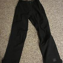 Women S Rei E1 Elements Waterproof Pants Black Size 6 Petite Photo