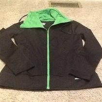 Womens Medium Saucony Black and Green Medium Jacket. Photo
