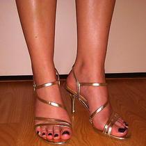 Worn Women's Gold Sandals Photo
